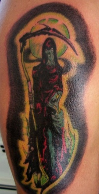 Grim reaper on green moon coloured tattoo